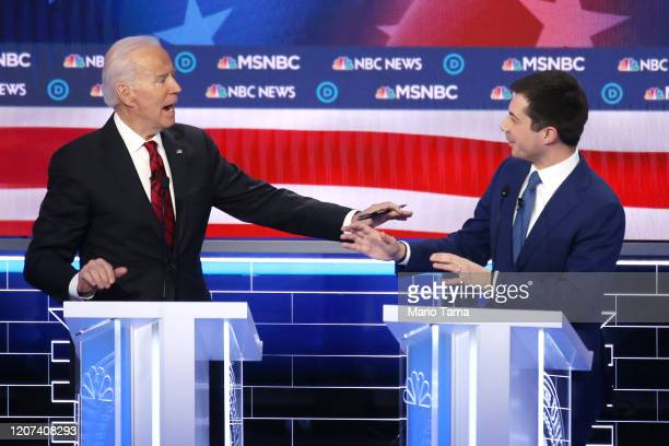 Democratic presidential candidates former Vice President Joe Biden and former South Bend Indiana Mayor Pete Buttigieg gesture during the Democratic...