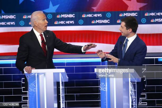 Democratic presidential candidates former Vice President Joe Biden and former South Bend, Indiana Mayor Pete Buttigieg gesture during the Democratic...