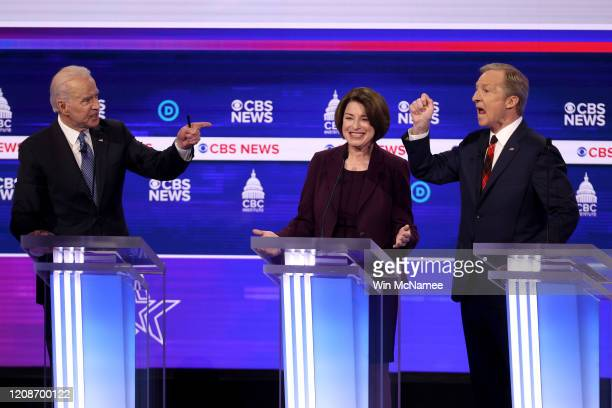 Democratic presidential candidates former Vice President Joe Biden and Tom Steyer debate as Sen Amy Klobuchar reacts during the Democratic...