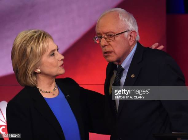 Democratic presidential candidates Hillary Clinton and Bernie Sanders confer during the NBC News YouTube Democratic Candidates Debate on January 17...