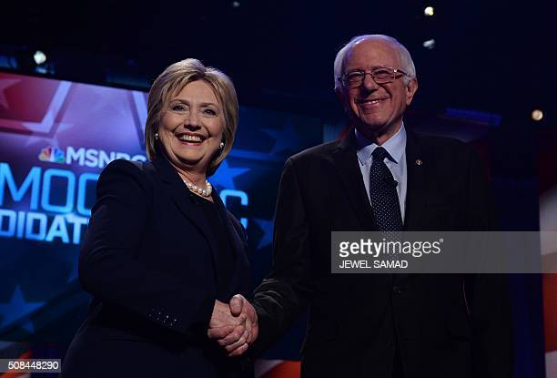 US Democratic presidential candidates Hillary Clinton and Bernie Sanders shake hands before participating in the MSNBC Democratic Candidates Debate...