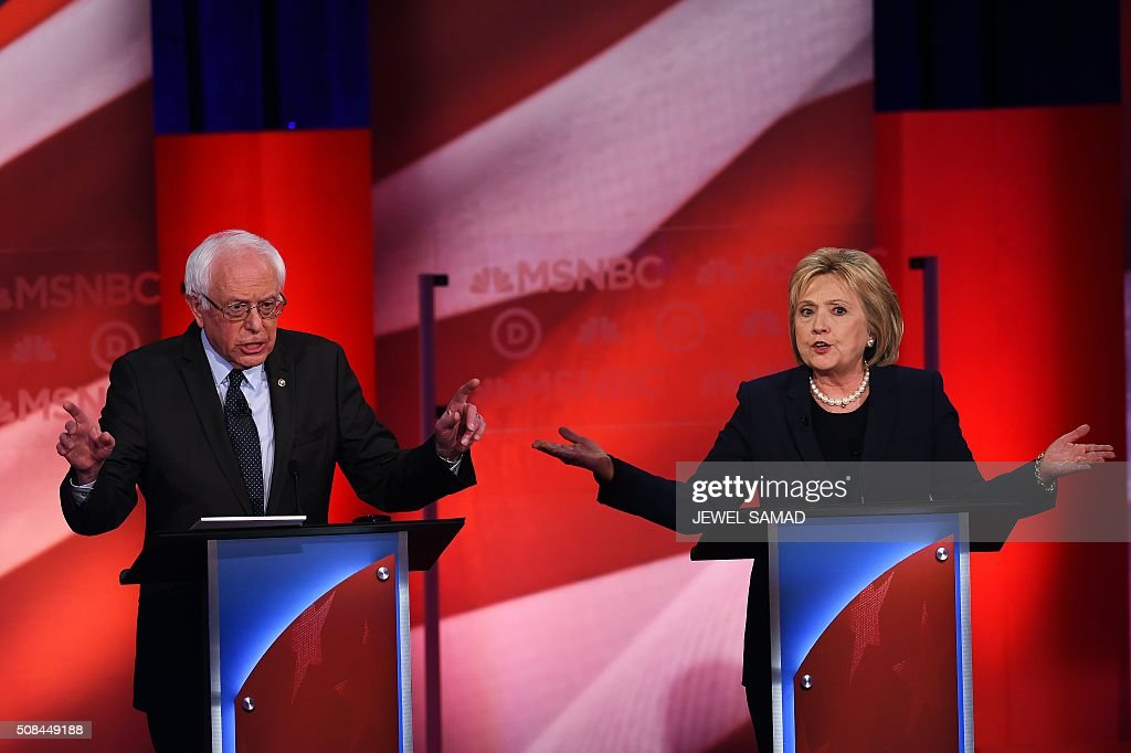 US Democratic presidential candidates Hillary Clinton (R) and Bernie Sanders participate in the MSNBC Democratic Candidates Debate at the University of New Hampshire in Durham on February 4, 2016. Clinton and Sanders face off on February 4, in the first debate since their bruising Iowa clash that the former secretary of state won by a hair, as they gear for a battle royale in New Hampshire. / AFP / Jewel Samad