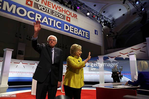US Democratic presidential candidates Hillary Clinton and Bernie Sanders wave after the PBS NewsHour Presidential Primary Debate in Milwaukee...