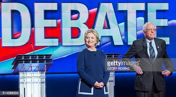 Democratic presidential candidates Hillary Clinton and Bernie Sanders await the start of the Democratic Debate in Flint Michigan March 6 2016 / AFP /...
