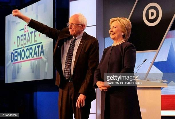 Democratic presidential candidates Hillary Clinton and Bernie Sanders participate in the democratic debate at Miami Dade College in Miami on March 9...