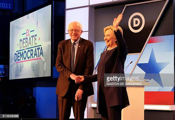 Democratic presidential candidates Hillary Clinton and Bernie Sanders shake hands before their debate at Miami Dade College in Miami on March 9 2016...