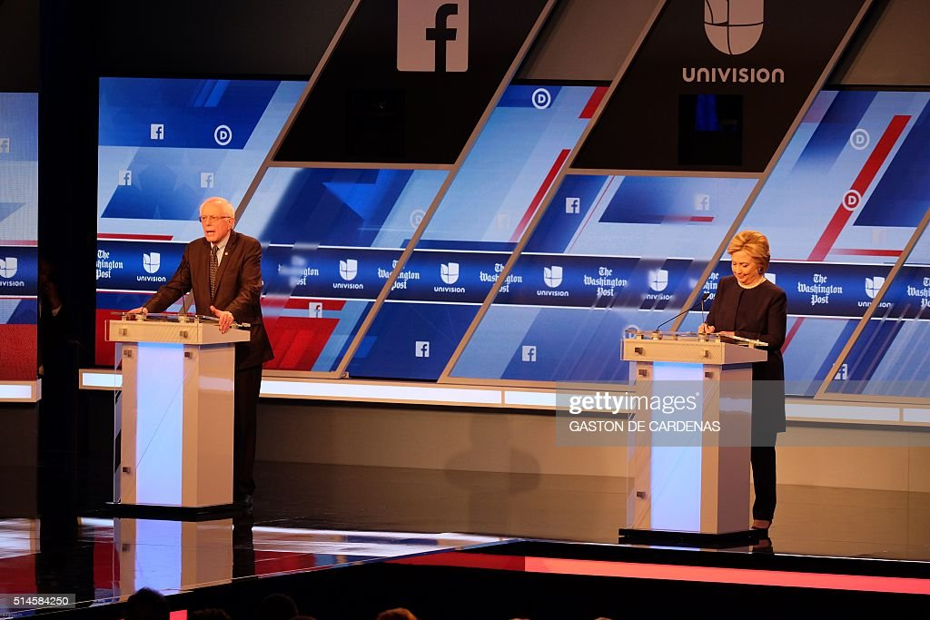 Democratic presidential candidates Hillary Clinton (R) and Bernie Sanders participate in the Univision and Washington Post democratic presidential debate at Miami Dade College in Miami, on March 9, 2016. / AFP / Gaston De Cardenas