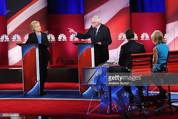 Democratic presidential candidates Hillary Clinton and Senator Bernie Sanders field questions from moderators Lester Holt and Andrea Mitchell during...