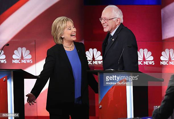 Democratic presidential candidates Hillary Clinton and Senator Bernie Sanders chat following the Democratic Candidates Debate hosted by NBC News and...