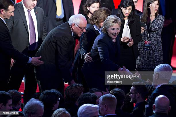 Democratic presidential candidates Hillary Clinton former Secretary of State right and Senator Bernie Sanders an independent from Vermont greet...