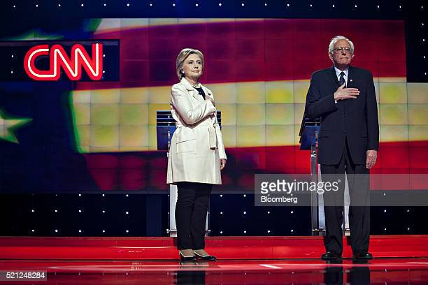Democratic presidential candidates Hillary Clinton former Secretary of State left and Senator Bernie Sanders an independent from Vermont listen to...