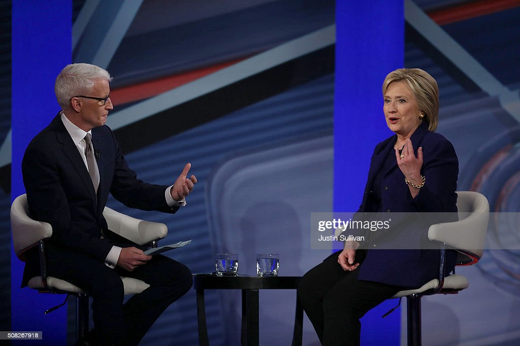 Democratic Presidential candidates Hillary Clinton sits with CNN anchor Anderson Cooper during a CNN and the New Hampshire Democratic Party hosted Democratic Presidential Town Hall at the Derry Opera House on February 3, 2016 in Derry, New Hampshire. Democratic and Republican Presidential are stumping for votes throughout New Hampshire leading up to the Presidential Primary on February 9th.