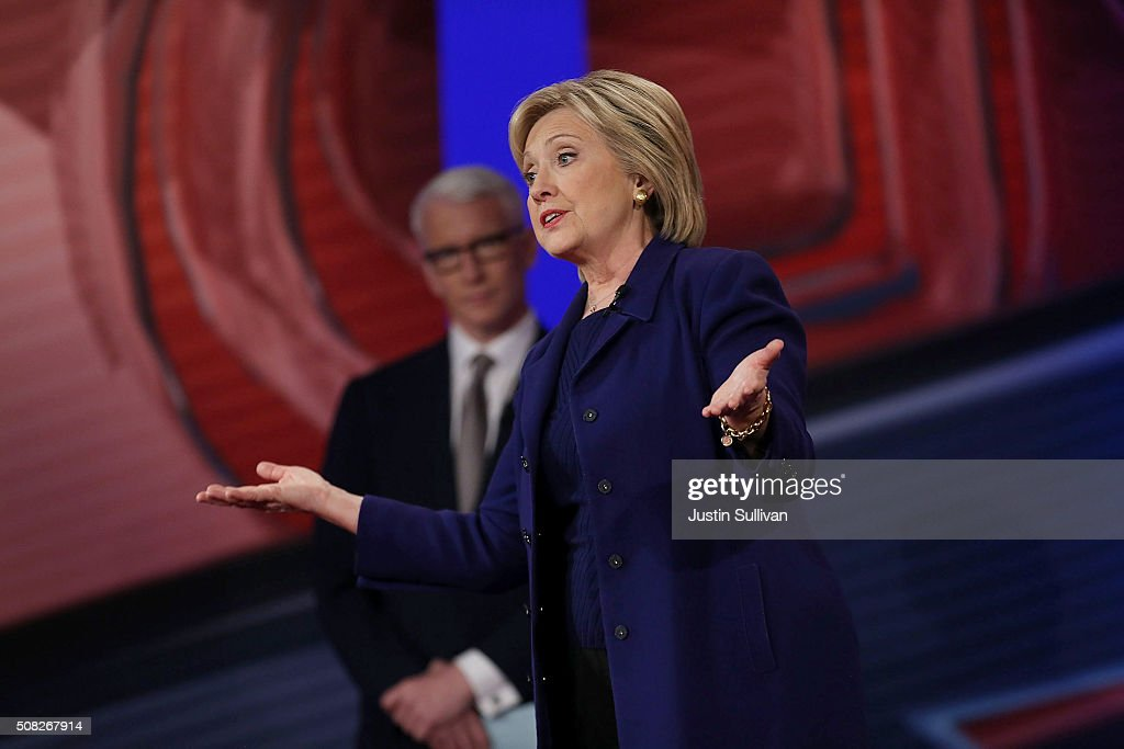 Democratic Presidential candidates Hillary Clinton stands on stage with CNN anchor Anderson Cooper during a CNN and the New Hampshire Democratic Party hosted Democratic Presidential Town Hall at the Derry Opera House on February 3, 2016 in Derry, New Hampshire. Democratic and Republican Presidential are stumping for votes throughout New Hampshire leading up to the Presidential Primary on February 9th.
