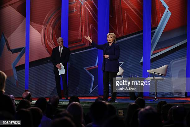 Democratic Presidential candidates Hillary Clinton stands on stage with CNN anchor Anderson Cooper during a CNN and the New Hampshire Democratic...