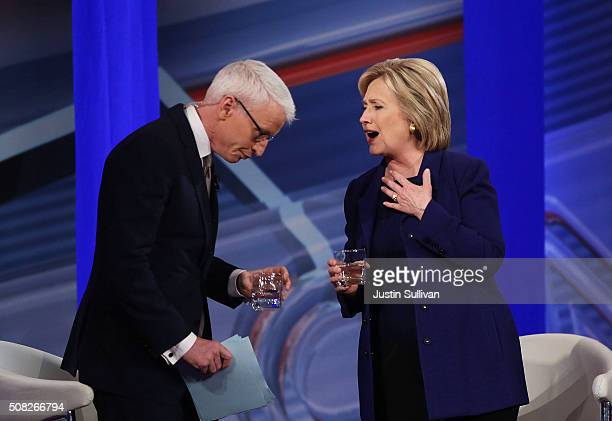 Democratic Presidential candidates Hillary Clinton stands with CNN anchor Anderson Cooper during a CNN and the New Hampshire Democratic Party hosted...