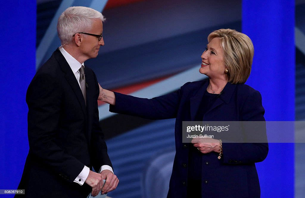 Democratic Presidential candidates Hillary Clinton stands with CNN anchor Anderson Cooper during a CNN and the New Hampshire Democratic Party hosted Democratic Presidential Town Hall at the Derry Opera House on February 3, 2016 in Derry, New Hampshire. Democratic and Republican Presidential are stumping for votes throughout New Hampshire leading up to the Presidential Primary on February 9th.