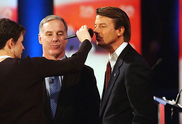 Democratic presidential candidates (L-R) Howard Dean and John Edwards have makeup applied prior to