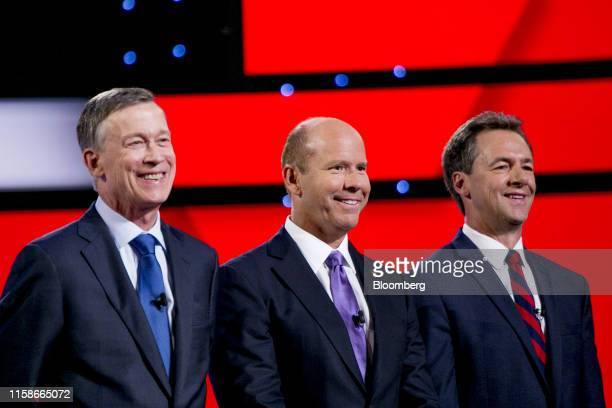 Democratic Presidential Candidates John Hickenlooper, former governor of Colorado, left to right, former Representative John Delaney and Steve...