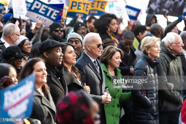 Democratic presidential candidates, Rep. Tulsi Gabbard , left, former Vice President Joe Biden, Sen. Amy Klobuchar , Sen. Elizabeth Warren , and Sen....