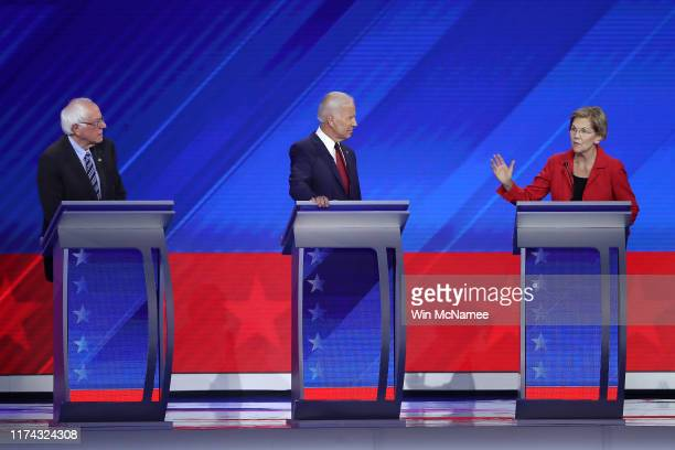 Democratic presidential candidates Sen Bernie Sanders and former Vice President Joe Biden look on as Sen Elizabeth Warren speaks during the...