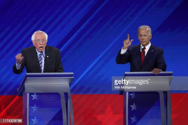 Democratic presidential candidates Sen Bernie Sanders and former Vice President Joe Biden interact during the Democratic Presidential Debate at Texas...