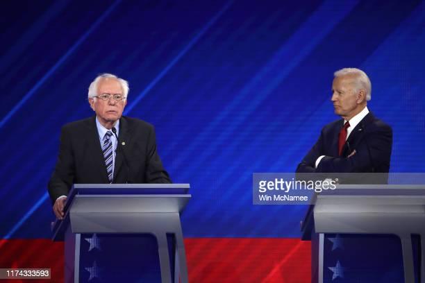 Democratic presidential candidates Sen. Bernie Sanders and former Vice President Joe Biden interact during the Democratic Presidential Debate at...