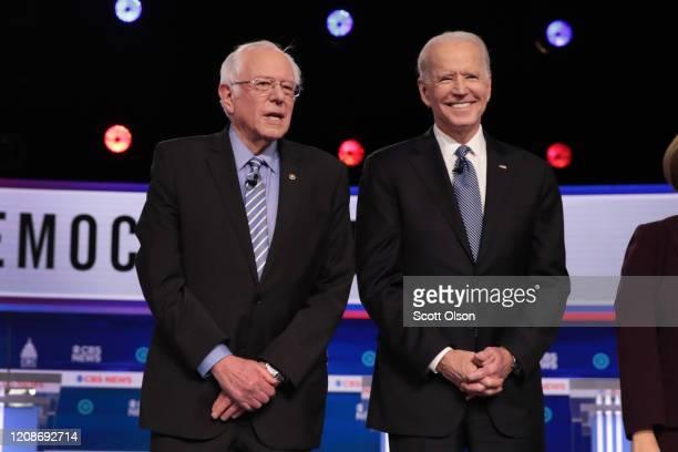 Democratic presidential candidates Sen Bernie Sanders and former Vice President Joe Biden arrive on stage for the Democratic presidential primary...