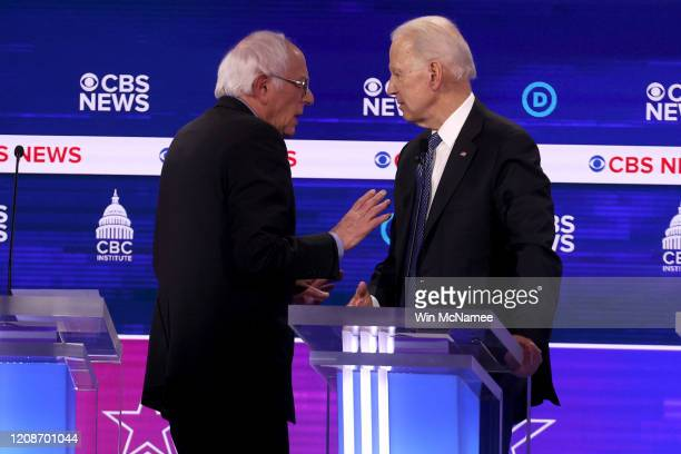 Democratic presidential candidates Sen Bernie Sanders and former Vice President Joe Biden speak during a break at the Democratic presidential primary...