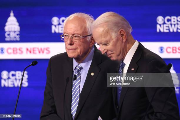 Democratic presidential candidates Sen. Bernie Sanders and former Vice President Joe Biden speak during a break at the Democratic presidential...