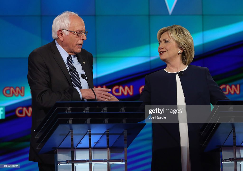Democratic presidential candidates Sen. Bernie Sanders (I-VT) (L) and Hillary Clinton take part in a presidential debate sponsored by CNN and Facebook at Wynn Las Vegas on October 13, 2015 in Las Vegas, Nevada. Five Democratic presidential candidates are participating in the party's first presidential debate.