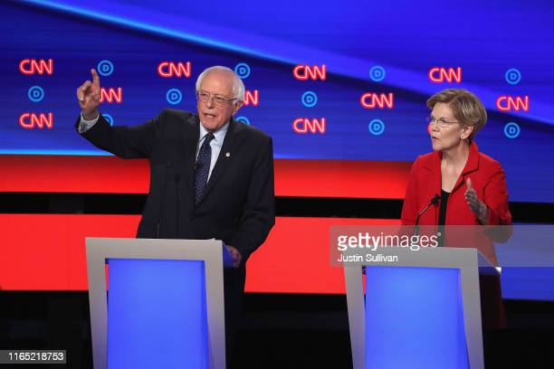 Democratic presidential candidates Sen Bernie Sanders and Sen Elizabeth Warren speak at the beginning of the Democratic Presidential Debate at the...