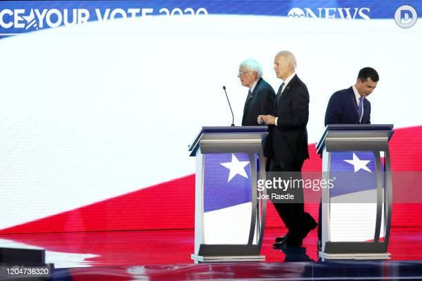 Democratic presidential candidates Sen. Bernie Sanders , former Vice President Joe Biden and former South Bend, Indiana Mayor Pete Buttigieg stand on...