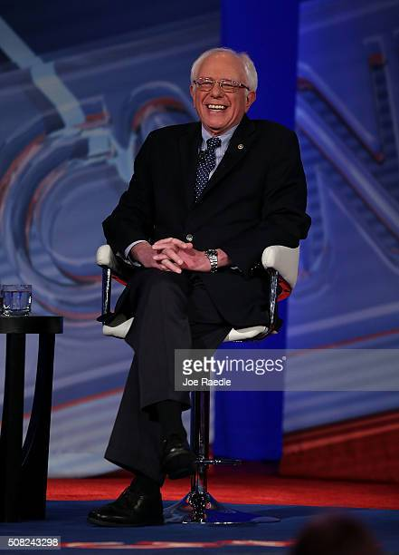 Democratic Presidential candidates Sen Bernie Sanders laughs during a CNN and the New Hampshire Democratic Party hosted Democratic Presidential Town...
