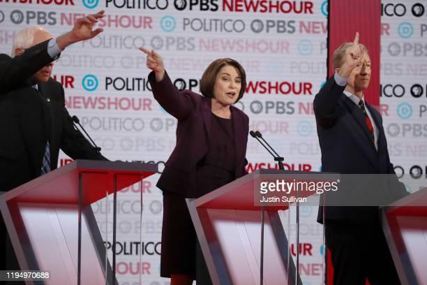 Democratic presidential candidates Sen Bernie Sanders Sen Amy Klobuchar and Tom Steyer gesture during the Democratic presidential primary debate at...