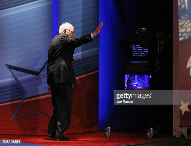 Democratic Presidential candidates Sen Bernie Sanders waves as he walks off stage after a CNN and the New Hampshire Democratic Party hosted...