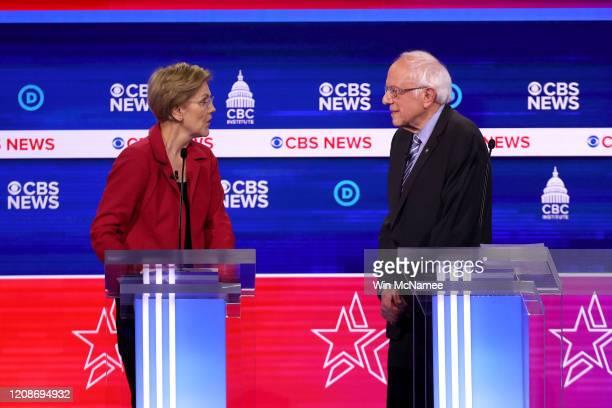 Democratic presidential candidates Sen Elizabeth Warren and Sen Bernie Sanders interact during the Democratic presidential primary debate at the...