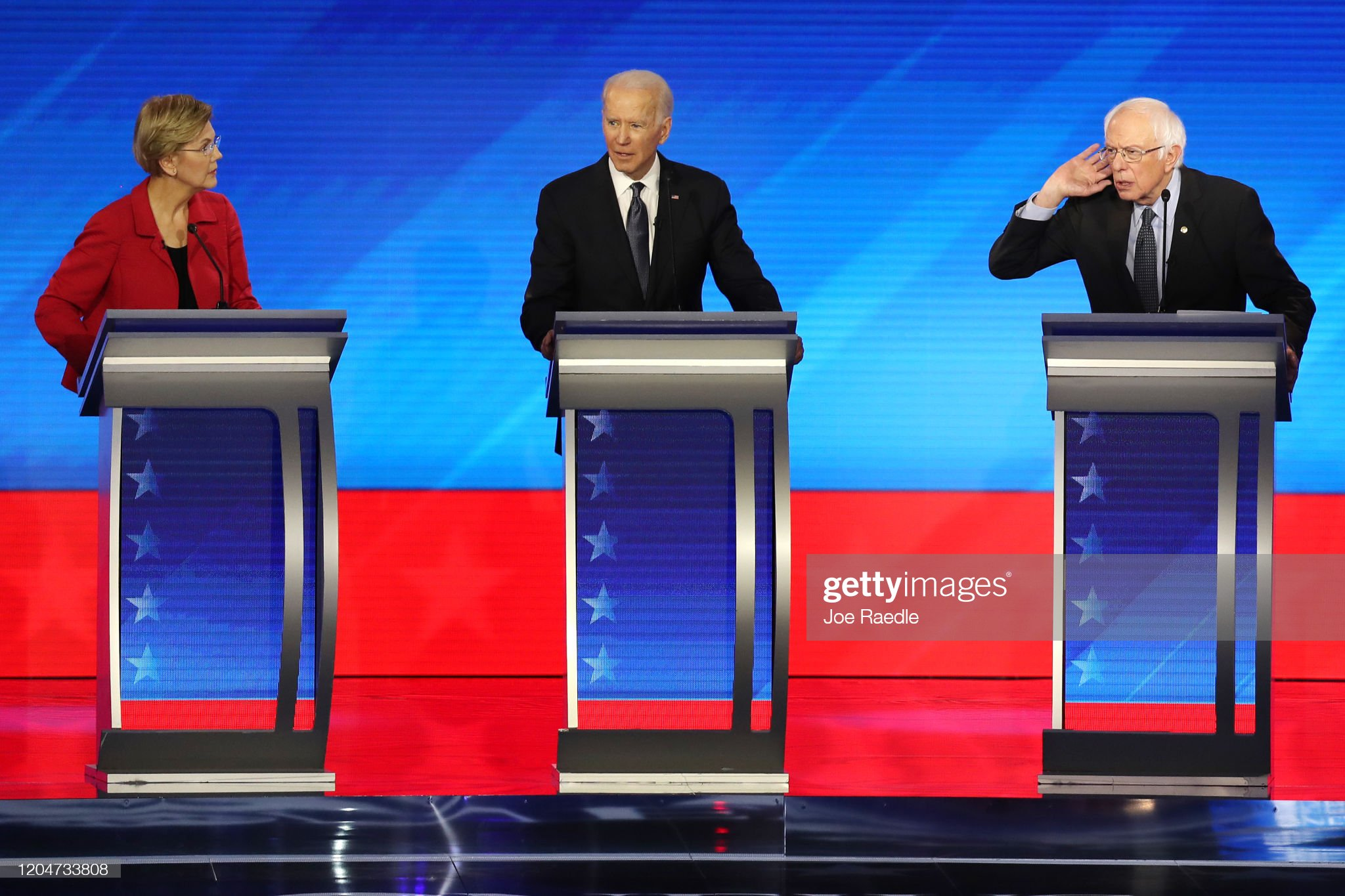Democratic Presidential Candidates Debate In New Hampshire Ahead Of First Primary Contest : News Photo