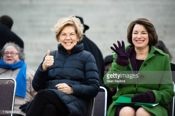 Democratic presidential candidates, Sen. Elizabeth Warren , left, and Sen. Amy Klobuchar gesture to the crowd during the King Day at the Dome rally...