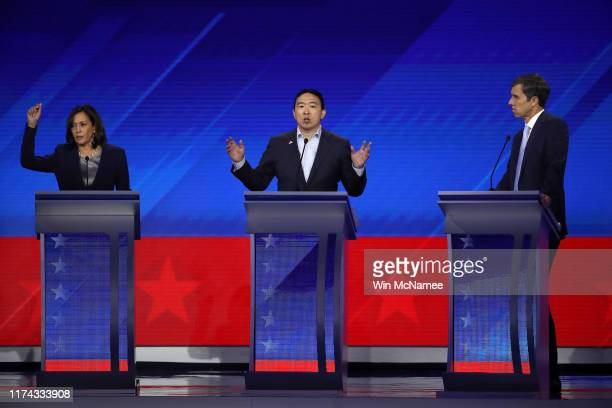 Democratic presidential candidates Sen Kamala Harris former tech executive Andrew Yang and former Texas congressman Beto O'Rourke interact on stage...