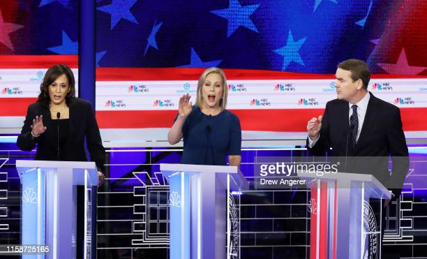 Democratic presidential candidates Sen Kamala Harris Sen Kirsten Gillibrand and Sen Michael Bennet speak during the second night of the first...