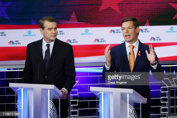 Democratic presidential candidates Sen Michael Bennet looks on as Rep Eric Swalwell speaks during the second night of the first Democratic...