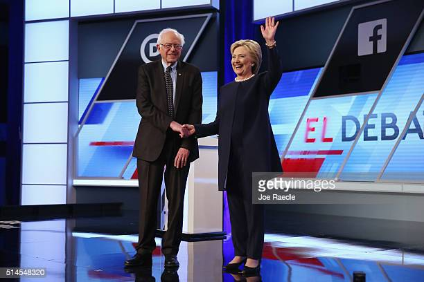 Democratic presidential candidates Senator Bernie Sanders and Democratic presidential candidate Hillary Clinton shake hands before the Univision News...