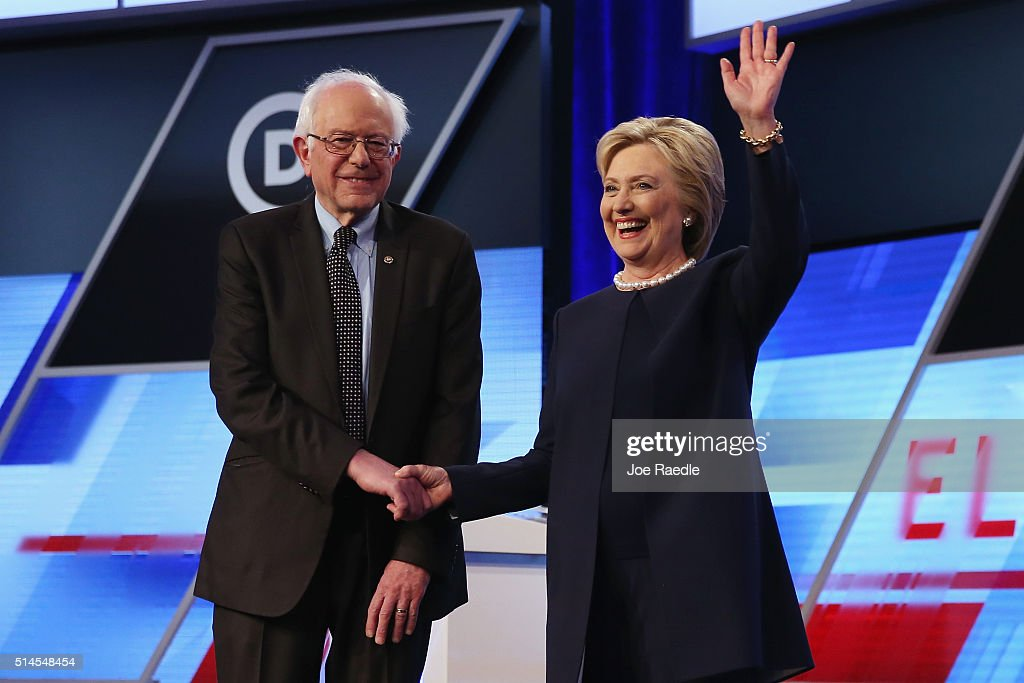 Democratic presidential candidates Senator Bernie Sanders (D-VT) and Democratic presidential candidate Hillary Clinton shake hands before the Univision News and Washington Post Democratic Presidential Primary Debate on the Miami Dade Colleges Kendall Campus on March 9, 2016 in Miami, Florida. Voters in Florida will go to the polls March 15th for the state's primary.