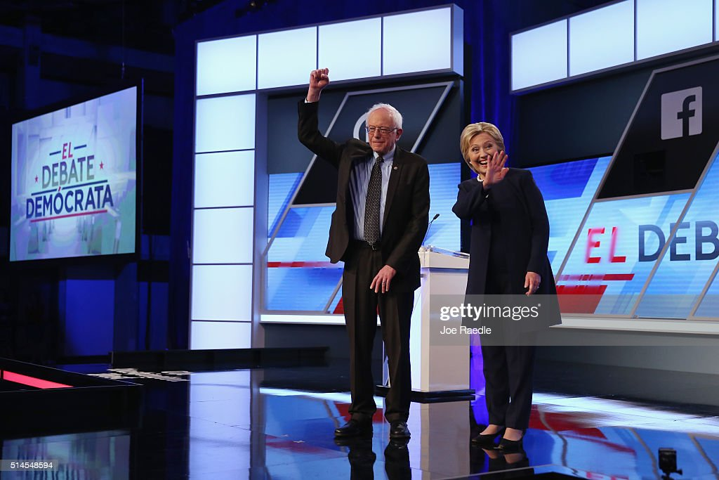 Democratic presidential candidates Senator Bernie Sanders (D-VT) and Democratic presidential candidate Hillary Clinton wave to supporters before the Univision News and Washington Post Democratic Presidential Primary Debate on the Miami Dade Colleges Kendall Campus on March 9, 2016 in Miami, Florida. Voters in Florida will go to the polls March 15th for the state's primary.
