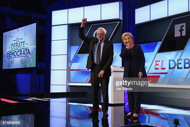 Democratic presidential candidates Senator Bernie Sanders and Democratic presidential candidate Hillary Clinton wave to supporters before the...