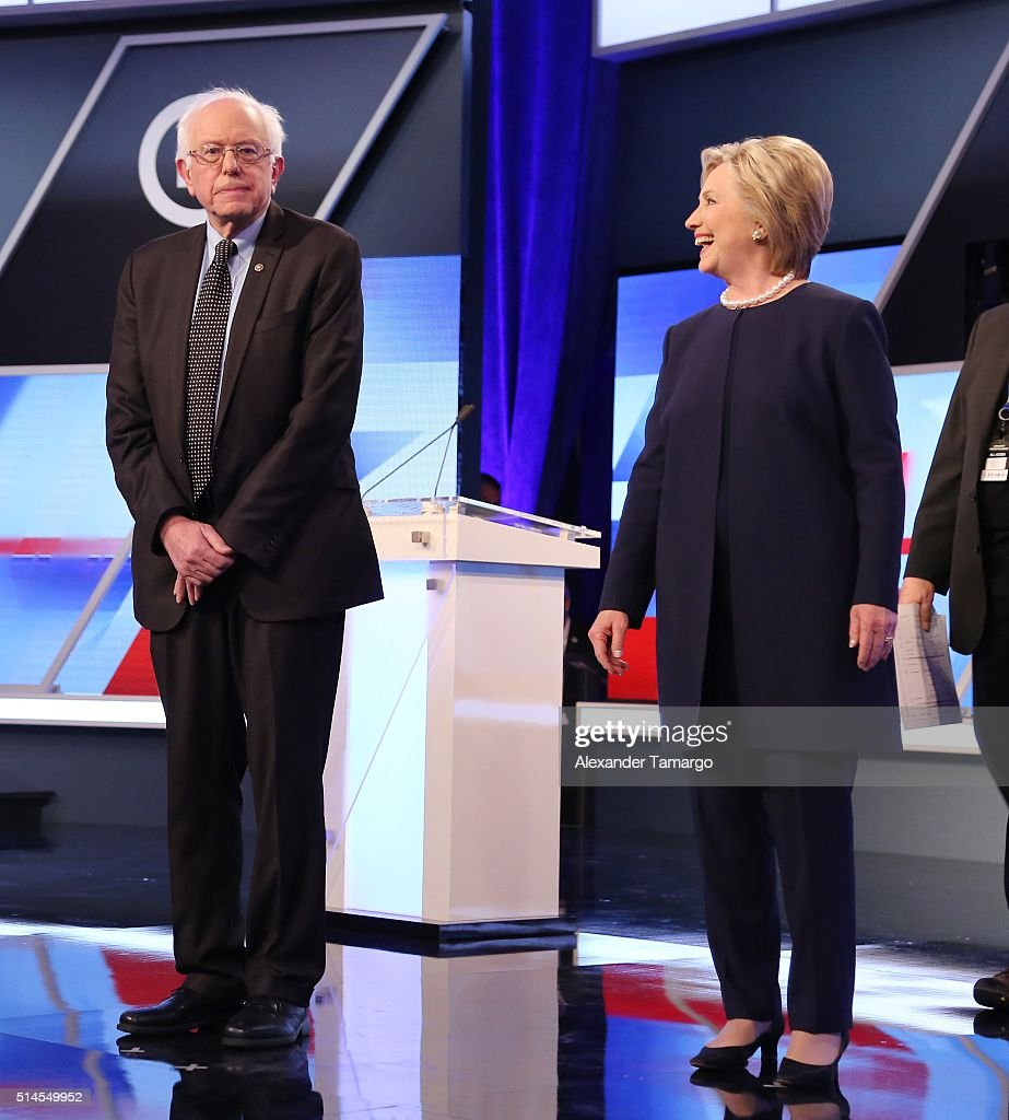Democratic presidential candidates Senator Bernie Sanders (D-VT) and Democratic presidential candidate Hillary Clinton are seen before the Univision News and Washington Post Democratic Presidential Primary Debate on the Miami Dade College Kendall Campus on March 9, 2016 in Miami, Florida.