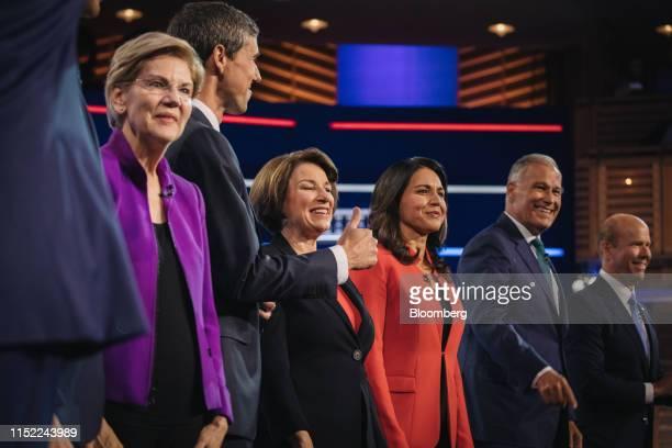 Democratic presidential candidates Senator Elizabeth Warren a Democrat from Massachusetts from left Beto O'Rourke former Representative from Texas...