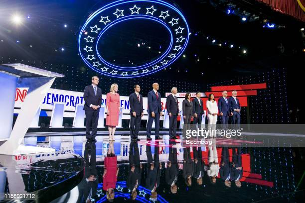 Democratic Presidential Candidates Senator Michael Bennet, a Democrat from Colorado, from left, Senator Kirsten Gillibrand, a Democrat from New York,...