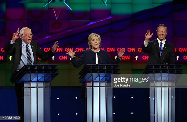 Democratic presidential candidates US Sen Bernie Sanders Hillary Clinton and Martin O'Malley take part in a presidential debate sponsored by CNN and...