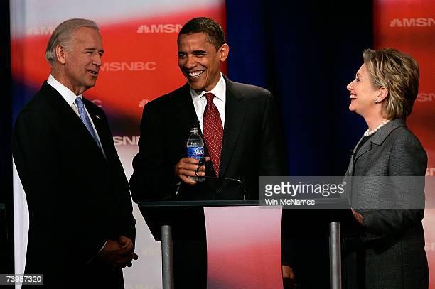 Democratic presidential candidates U.S. Sen. Joe Biden , Sen. Barack Obama and Sen. Hillary Clinton talk prior to the first debate of the 2008...